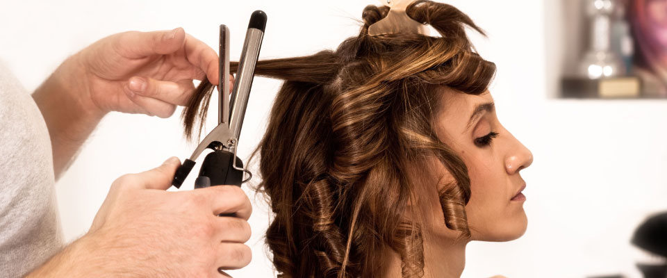 Woman getting hair styled
