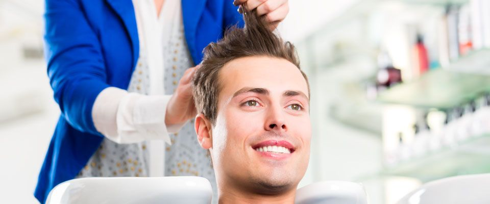 Man getting hair cut and styled